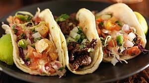 Tacos lying on a plate looking delicious