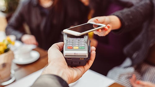 A smartphone is used to make a payment